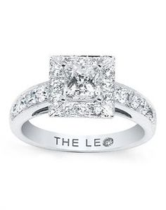 A princess-cut Leo diamond is the scintillating center of this sensational diamond engagement ring for her. Brilliant round Leo diamonds fra...