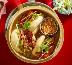 These soft Chinese bao buns are stuffed to bursting with spicy pork and topped with crushed chilli peanuts