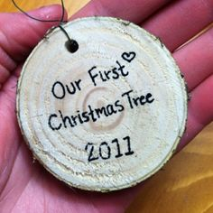 "DIY rustic ""Our First Christmas Tree"" ornaments. A slice off the bottom of your first christmas tree. Noel Christmas, Diy Christmas Ornaments, Winter Christmas, All Things Christmas, Holiday Crafts, Holiday Fun, Christmas Decorations, Rustic Christmas, Couple Ornaments Diy"