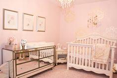 Pretty in Pink Nursery. Baby girl nursery fit for a princess, pale pink walls, gold stencil, mirrored dresser, custom artwork, pottery barn kids rug.