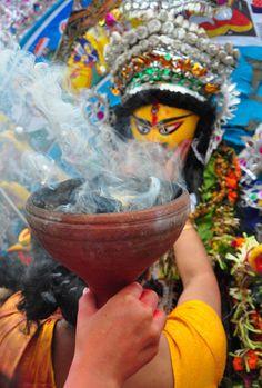 Durga holy smokes for liberation.   Durga Puja Festival in India