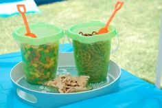 Beach theme, could have buckets and spades and in the buckets sweets for the evening reception which could be favours and you provide little bags which maybe are personalised