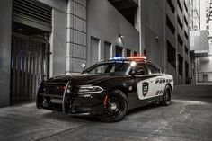 """The 2017 Dodge Charger Pursuit is one of the modern examples of those law enforcement vehicles. The vehicle makes the bold statement of """"nothing can get away from this car on this highway""""."""