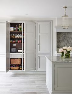 The owners of this North London house love nothing more than entertaining, and so built a kitchen extension in order to give them the space they needed. The clients had spent a lot of time researching kitchens and had already chosen cabinetry in Martin Moore's New Classic design. This contemporary classic look has been beautifully showcased by a palate of cool greys. Corner, Bookcase, Shelves, Different Perspectives, Home Decor, Shelving, Homemade Home Decor, Bookcases, Interior Design
