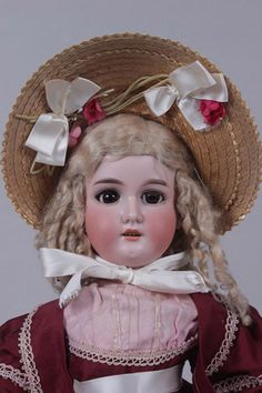 In 1908-1909, Armand Marseille of Germany made a sister pair of bisque dolls, one with blue glass eyes and one with brown. They had pretty long ringlets and ...