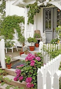 I love this beautiful cottage entryway. It looks so inviting, doesn't it?  I'd love to help you find your own cottage. Visit www.vickystewarth... and let's see if we can find YOUR next home!