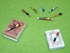 how to: writing pens:   I've made these. Very easy, very pretty. Jewelry head pins are the exact right size for these, though you have to be careful with the number & kind of beads you'd -- like -- to use versus what actually fits on the  pin. Pix later in Mary Beth's Dollhouse.