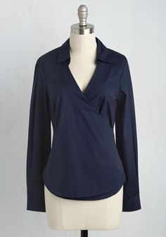 You feel so confident in this professional top's chic sensibilities that you invite reactions from your colleagues! As suspected, compliments over the wrap silhouette of this collared blouse by Closet London are as impressive as your weekly numbers, while admiration over its navy blue hue and gold-buttoned sleeve cuffs soar like you do through the ranks. Work it!