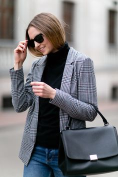 A checked blazer is always a good match for black turtleneck and denim
