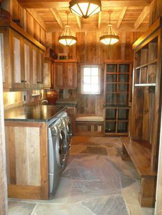 Wood laundry room with stone floor (Sunlit Architecture)