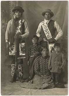 An Ojibwe family poses for a portrait in a photographer's studio circa 1905. Description from pinterest.com. I searched for this on bing.com/images