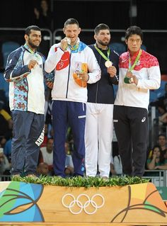 #RIO2016 Lukas Krpalek of Czech Republic celebrate his gold medal with Elmar Gasimov of Azerbadjan and Cyrille Maret of France after the final Judo men's...