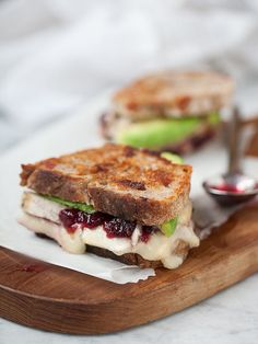 Turkey cranberry avocado and grilled brie cheese sandwich - perfect for all the thanksgiving leftovers and when you are too tired to cook the day after thanksgiving!
