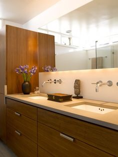 not necessarily these specifically but I am a fan of the wall mounted faucet.  I am a clean freak and this seems so tidy