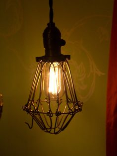Vintage style trouble light cage lighting swag hanging lamp pendant industrial, steampunk. $50.00, via Etsy.