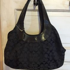 Authentic Coach shoulder bag Great black coach bag, very clean, tons of room, has a little pillar the leather as shown in last picture, doesn't show when wearing bag, has no effect on the bag, trade value higher Coach Bags Shoulder Bags