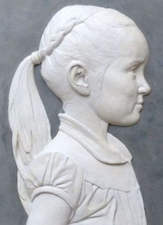 Coloured earthenware in limed ash frame Portrait Sculptures / Commission or Bespoke or Customised sculpture by artist Tristan MacDougall titled: 'Bas-relief Child Portrait (Little Girl Profile Cameo panel statue)'