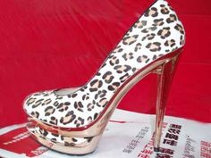Christian Louboutin White Leopard Grain Pumps!