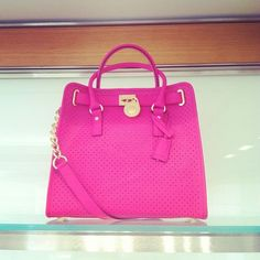 Bright, pink and perforated at Michael @MichaelKors #MKPrefall