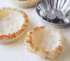 Ingredients 2 2/3 cups sweetened coconut 2 egg whites Directions Preheat oven to 350° F. In a food processor fitted with a metal blade, combine the coconut with the egg whites and pulse until well ground. Lightly coat four 4-inch tart pans with cooking spray. Press the coconut into the tart pans using a firm hand, working it over the bottom and up the sides. Bake until the coconut turns golden around the edges and is set in the center, 15 to 20 minutes.