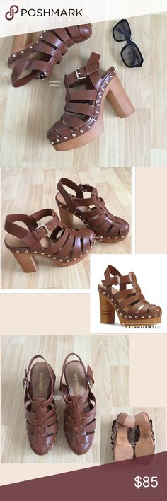 "Nine West Caged Platform Chunky Heel Sandals Brown These super cute caged chunky heeled sandals by Nine West is definitely the retro vintage throwback look to the 70s. Pair with a mini skirt or cropped pants & cropped tee, you'll literally be stepping out in fashionista style. Pair with some bell bottom jeans & a graphic tee and give a shout out to the 70s. Gold anchor studs to elevate your fashionista style. Adjustable strap. Boosting a 4"" heel with a 1"" platform these sandals are light…"