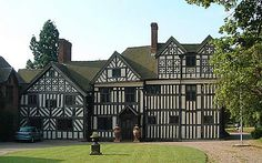 Somersal Hall in Derbyshire. Largely built in 1564 it's a great example of Elizabethan timber framing. Even though the framing is a structural part of the building, effort has gone in to making the most of the contrast and pattern created by the wood against the infill.