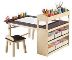 Features: -UV-coated tabletop. -Table has side storage. -Paper roll holder, canvas storage bins, top storage cubbies and more. -Creates the perfect setting for drawing, crafts and creative activit