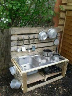 Mud  kitchen, recycle the sink from the rv and turn it into a outdoor sink