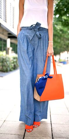 The right accessories will give your look a timeless look. Our chic orange Italian leather and suede tote is adds a bold pop of color to your style when paired with chambray pants and a crisp white tank   Banana Republic