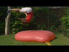 giant water balloon exploding in super slow-motion:-}
