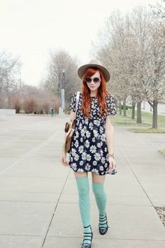 Gorgeous flowers printed mini dress with leather hand bag and black sandals and cool cap