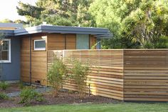 Exterior, new fence and master bathroom addition beyond - midcentury - exterior - san francisco - by Klopf Architecture