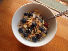 VEGAN SNACK nature;s path qia cranberry vanilla superfood cereal with soy milk, sliced almonds, and blueberries