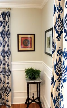 bold pattern on window treatments, chair rain and wainscotting