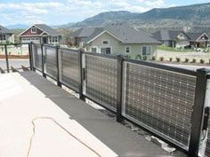 A balcony railing made with solar panels.
