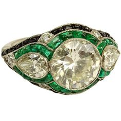 Very Fine Art Deco Design Approx. 4.25 Carat Cut Diamond, 1.50 Carat Colombian Emerald and Platinum Engagement Ring. - Price Estimate: $20000 - $30000