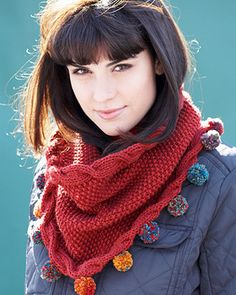 A gorgeous seed stitch cowl edged with sideway cables becomes more funky with pompoms made in a coordinating shade Bernat Mosaic. Knit in Bernat Super Value. free pattern