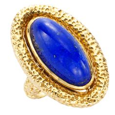 "Van Cleef & Arpels, An 18K Gold and Lapis Ring, centering an oval shaped lapis mounted in yellow gold, signed ""VCA"" and numbered 10 118996, size 7.5, circa 1975."