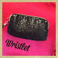 SALE Black evening wristlet This is a new wristlet made of black metal mesh. Exposed gold zipper at top, and hardware attaching the remove able strap. Inside lined with red satin. Perfect for the holidays. Bags Clutches & Wristlets