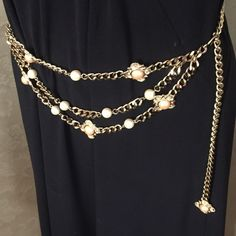 """Vintage Gold-Tone Chain Link Belt w Faux Pearls A stunning vintage belt in a weighty Gold-Tone chain link with additional draping chains in the front that have faux pearls and half-pearl embellished shapes.  Measures 40"""" from end-to-end. Hook closure. In excellent preowned condition (one half-Pearl has a tiny pink spot that I did not want to try and remove but not noticeable except upon close scrutiny). Vintage Accessories Belts"""