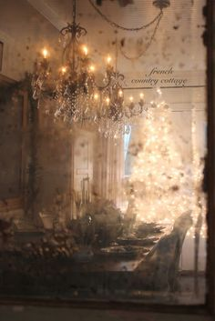 The glow from the tree is reflected in a beautiful, old mottled worn mirror, on the other side of the room~❥