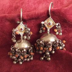 """Silver,Afghanistan Description These earrings with silver and coral grelots have the typical design of small domes which mean if you translate the word """"gushwar-e-kafasi"""" birdcages. Arabic Jewelry, Tribal Jewelry, Jewelry Art, Antique Jewelry, Women Jewelry, Jewellery, Silver Earrings, Silver Jewelry, Drop Earrings"""
