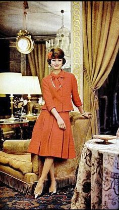 1962 Marie-Helene in Chanel's red wool suit with pleated skirt