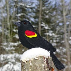 A red-winged blackbird ornament crafted from felt.