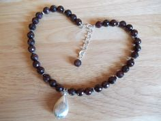 Garnet necklace with brushed silver plated copper teardrop pendant £10.00