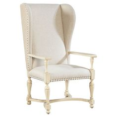 Wingback arm chair with a nailhead-trimmed upholstered seat and back.  Product: ChairConstruction Material: Wood...