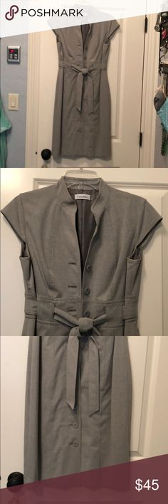 Calvin Klein dress. Super cute. EUC. Size 8. Very professional grey suit dress. Nice and structured. Size 8. My hips are too much for it but I wish I could get back into it! Calvin Klein Dresses Midi