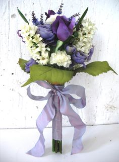 Purple roses and ranunculus with white hyacinths and carnations bridal bouquet