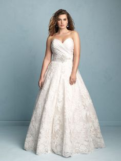 W351 A gorgeous overlap of textures makes this satin, tulle and lace combination gown stand out.