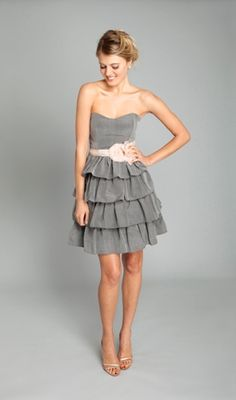 Hmmm maybe grey dress with pink sash for my bridesmaids and the opposite for my maid of honor :D lol